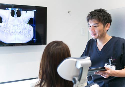 歯周病専門医による治療